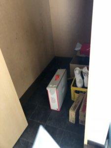 富山県富山市、マンション内不用品回収玄関部分写真